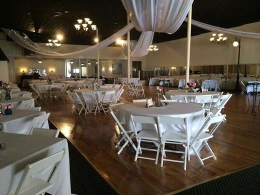 Setup with White Garden Chairs and Drapes from the ceiling