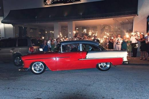 There are many ways to exit your wedding. Sparklers and a vintage car is one of the best!